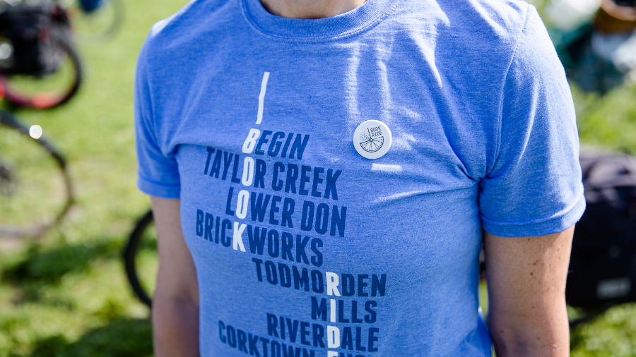 Book Ride T shirt with a custom badge